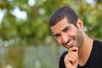 Portrait of a handsome arab man face outdoors