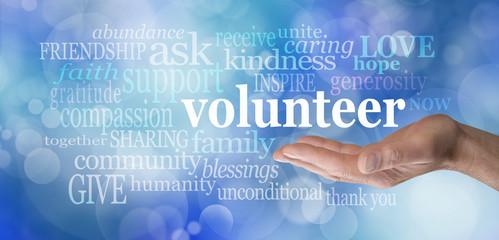 Volunteers needed hand gesture on blue bokeh