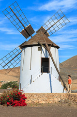 Woman standing near windmill in Tiscamanita, Fuerteventura