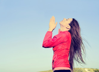 Woman arms raised up blue sky praying thankful for freedom