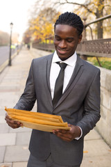 business man holding envelopes.