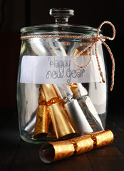 Rolled Wrapping Foils in a Jar with Happy New Year