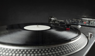 Turntable playing vinyl close up with needle on the record