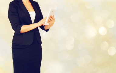 younf elegant woman in buisiness suit holding tablet in front of