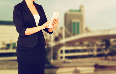 woman in business suit on a city building background. filtered i