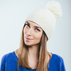 Fashionable girl in winter knitted clothes