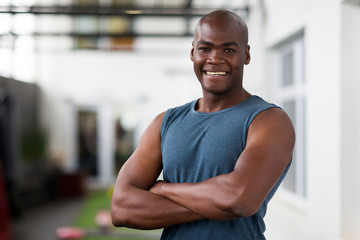 african american man with arms crossed in gym