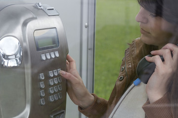 dial a phone number in a telephone booth