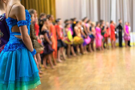 ballroom dancers standing in a row
