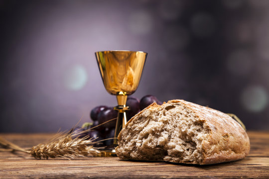 Sacred objects, bible, bread and wine.