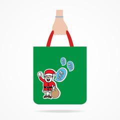Hand with Christmas shopping bag.