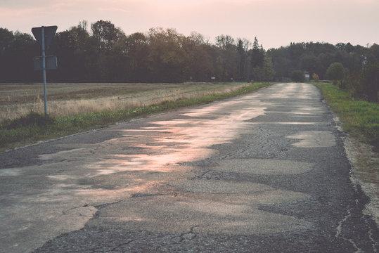 wet asphalt road with sun reflections. Vintage.