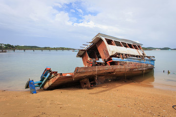 Old wooden boat stand on the beach