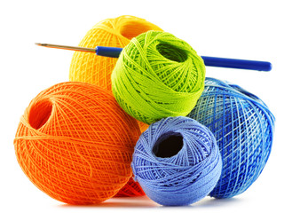 Colorful yarn for crocheting and hook isolated on white