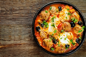meatballs with olives and egg in tomato sauce