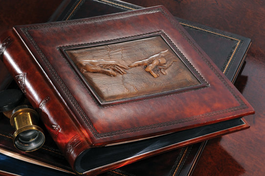 Expensive leather photo album with a reproduction of Da Vinci