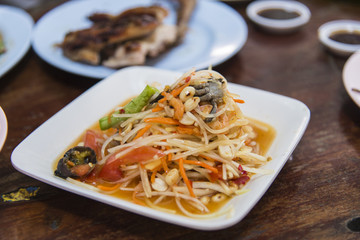 spicy papaya salad with salted crab and fermented fish