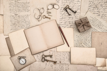 antique accessories, open book and old handwritten letters