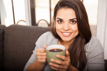 Happy girl enjoying coffee