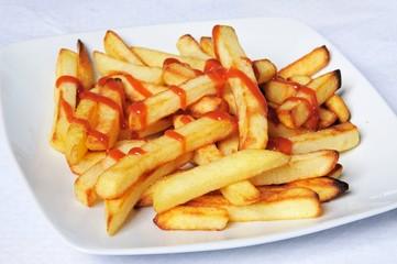 Frenchg fries and ketchup © Arena Photo UK