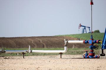 pipeline and oil pump jack on oilfield