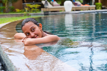 Attractive young Asian woman in a swimming pool