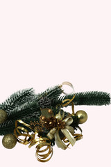 Fir-tree branch with Christmas decorations.