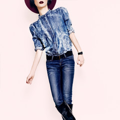 Glamorous lady in a stylish jeans clothes.