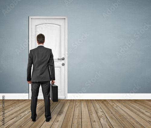 Man Standing In Front Of The Door Exit Landscape Stock Photo