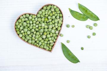 fresh green peas in heart shape
