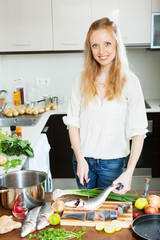Positive housewife cooking saltwater fish