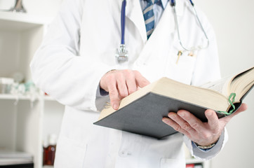 Doctor reading a medical book