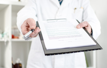 Doctor showing notes