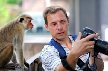 Photographer shows a monkey photo shoot
