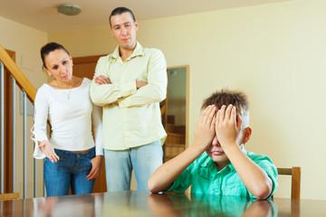 Ordinary family of three  having conflict