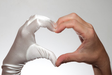 White elegant heart shaped glove hand isolated white background