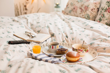 Breakfast served in bed with coffee and juice.