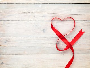 Valentines day background with heart shaped ribbon
