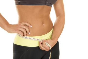woman stomach measure hand on hip