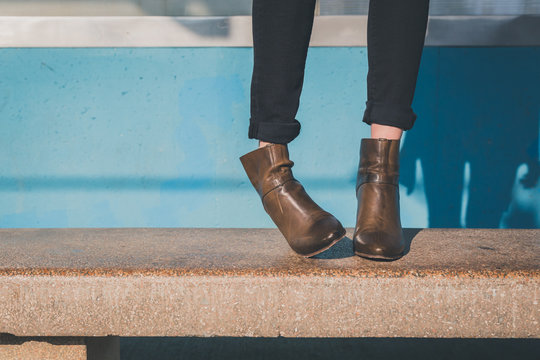 Detail of ankle boots in a metro station