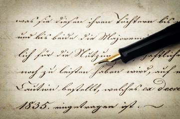 calligraphic handwritten text and vintage ink pen