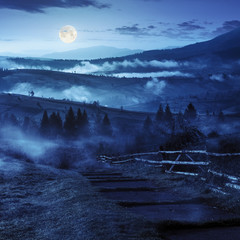 steps down to village in foggy mountains at night