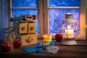 Fototapete - Warming tea in a winter cottage