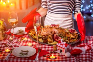 Woman preparing for Christmas dinner