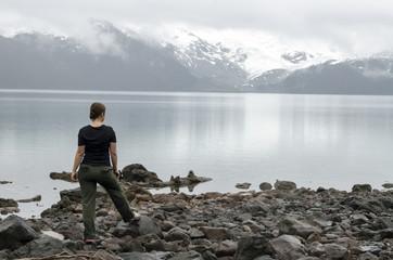 Hiker observing mountain lake