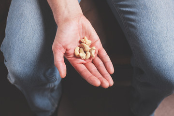 Hand with cashew nuts