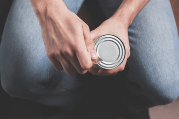 Man opening tin