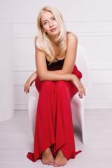 Hot blonde girl posing in white room