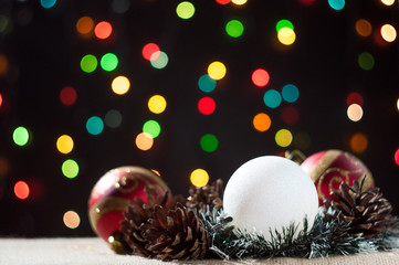 New Year's and Christmas balls with cones on background bokeh