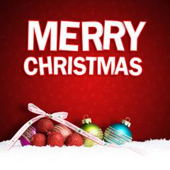 Merry Christmas Gruß und Weihnachtskugeln im Schnee